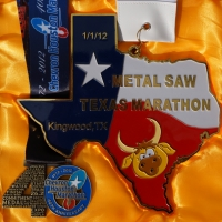 2012 Texas Marathon Medal vs. 2012 Houston Marathon Medal